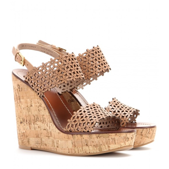 a8bbb13f608 Tory Burch Floral Perforated Wedge Sandals. M 5b608adbb6a9429056453361